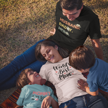 family of four wearing t shirts while at the park