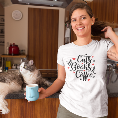 happy woman wearing a t shirt mockup with her cat at the kitchen a18971