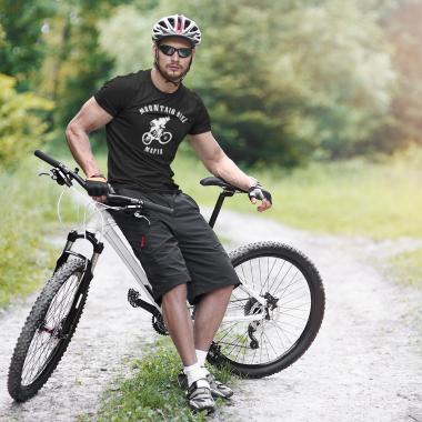 t shirt mockup of a man riding his mountain bike 38256 r el2