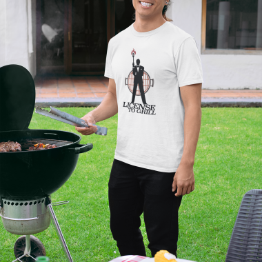 t shirt mockup of a man with a dad hat grilling at a bbq party 29718